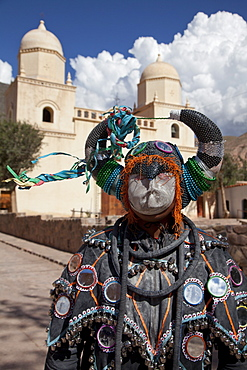 Reveller in costume and mask at Humahuaca carnival in Jujuy province in the Andes region of Argentina, South America