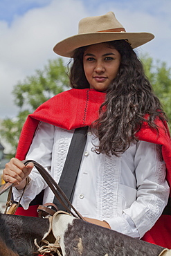 Woman in a parade of gauchos in traditional costumes in Salta, Argentina,South America