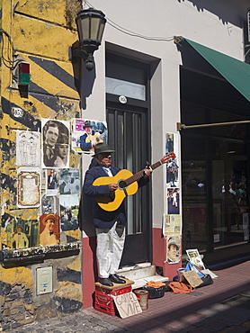 Tango musician in the streets of the old barrio of San Telmo, Buenos Aires, Argentina, South America