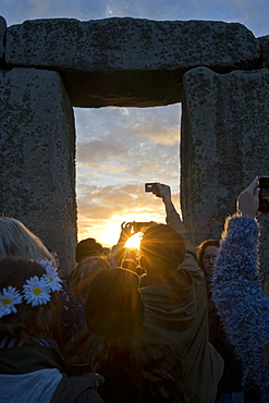 Revellers gather at historic monument for Summer Solstice celebrations on 21 June 2016, Stonehenge, UNESCO World Heritage Site, Wiltshire, England, United Kingdom, Europe