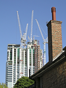Uk. New office developments and old council houses in canary wharf in east london