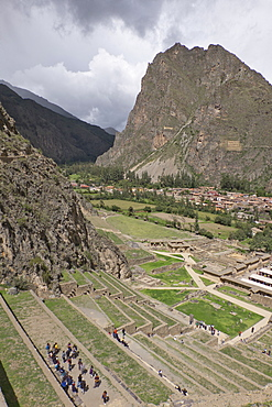 Tourists visit the ruins of the Inca archaeological site of Ollantaytambo near Cusco. Peru, South America