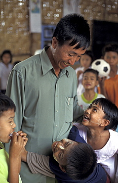 Thailand steven moses, director of nccm, with burmese refugee children at school, mae sot