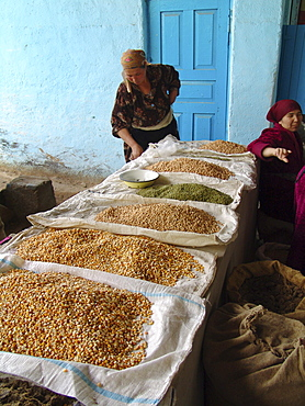 Uzbekistan woman selling corn, beans and lentils, shakhrisabz