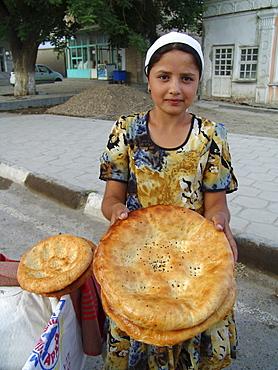 Uzbekistan girl selling bread, bukhara