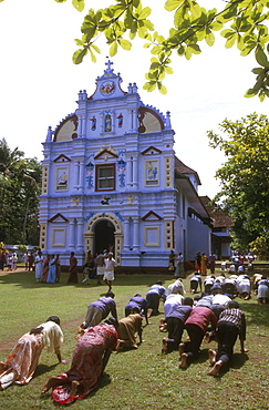 India - religion - christian pilgrims walking around church on hands and knees as penance, good friday, valliappally, kerala