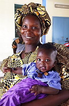 Gambia woman and waiting at clinic birkana