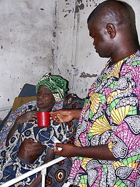 Gambia victim monica being cared for by nurse saidyba, birkama