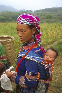 Vietnam hmong tribal woman and bo village, lai cai district