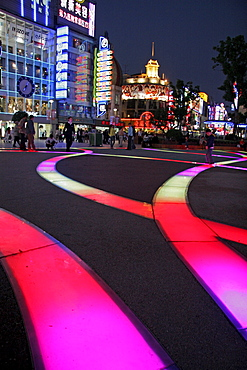 China nanjing road, one of the main shopping and tourist streets of shanghai. Neon signs.