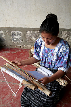 Guatemala woman using backstrap loom. Santa catarina palopo, on lake atitlan