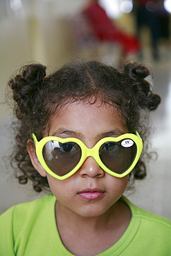 Honduras girl with sunglasses. slum barrio of chamelecon, pedro sula