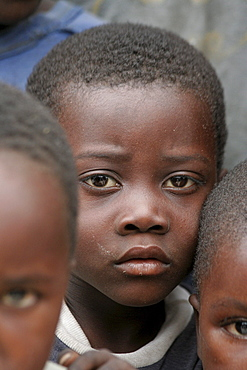 Namibia a feeding centre hungry children in rundu. Most of these children aids orphans, or positive themselves, or both. A catholic church organization provides them with a daily meal, perhaps only decent food they. hunger is evident in their eyes expressions