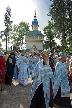 Russia pechersky monastery, near pskov. Procession of priests on annual celebration