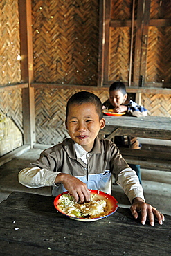 Myanmar eating meal in school, myitkyina, a largely kachin community in north burma near chinese border