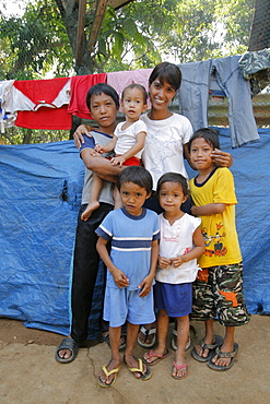 Philippines a mother and her children at home in their slum dwelling, bagong silangan, quezon city, manila