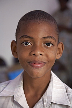 Jamaica. Boy at sunday mass at catholic church in chester castle
