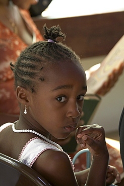 Jamaica. Girl at sunday mass at catholic church in chester castle