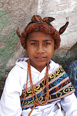 East timor boy wearing traditional dress including ikat weaves and beads, oecussi-ambeno