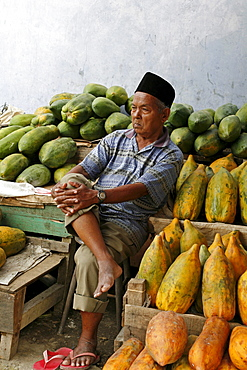 Indonesia man selling papayas, banda aceh, aceh, 2 years after the tsunami