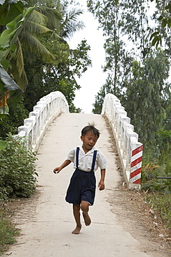 Vietnam hoa binh commune in vinh long province. this bidge across a river and next tohoa binh primary school, was constructed by crs (catholic relief services) to help the kids get to their classes. previously many of them had to walk several miles in order to attend school