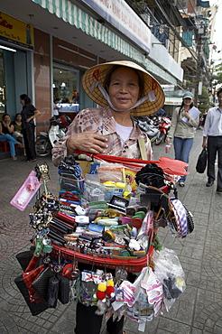 Vietnam saigon street trader selling a large range of everyday items