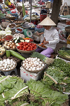Vietnam woman selling fruit, vegetables and eggs, hoi an