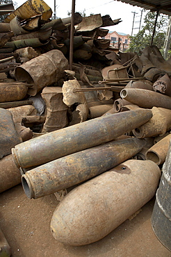 Vietnam unexploded ordnance, both bombs dropped by americans and land mines laid by both sides during the vietnam war, remain a big problem in central vietnam for children and adults alike. in response, crs has implemented a mine risk education program in quang tri province near the former khe sanh battlefield. this image shows the yard of a scrap metal merchant in tan hop. 80% of the steel comes from bombs, either exploded or unexploded. collecting and selling scarp metal has for long been an income for many poor people in the area