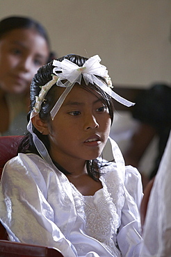 Guatemala catholic first communion and mass at remate, el peten. girl waiting to give first confession