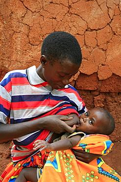 Burundi woman breast feeding baby. Gitera.