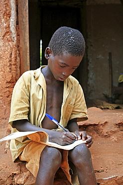 Burundi boys doing their homework after school, gitera.