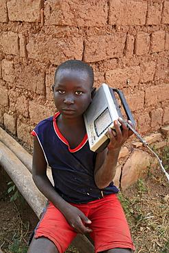 Burundi boy with radio, gitera.