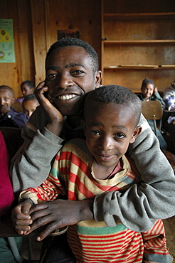 Disability, ethiopia. Urban development project of the daughters of charity, kabille 18, addis ababa. The project helps poor people with disabilities and health problems. Father and son at the center