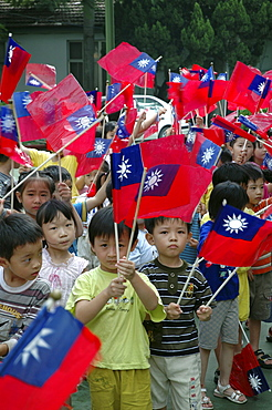 Street scene, taiwan. Kindergarten children waving the flag of taiwan, taichung