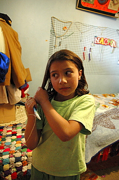 Colombia marly juliet, 7, of the slum of altos de cazuca, bogota, brushing her hair