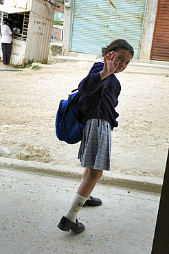 Colombia marly juliet, 7, of the slum of altos de cazuca, bogota, heading off to school