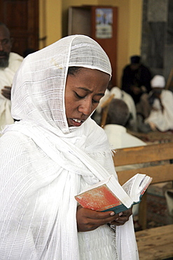 Ethiopia the maryam feast, feast of mary, at axum. Woman reading scriptures, inside the church of saint mary of zion