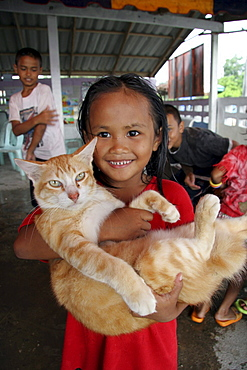 Thailand girl with cat. Pattani