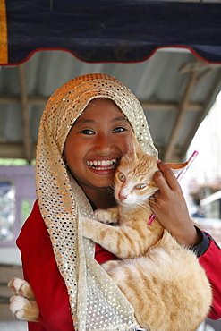 Thailand moslem girl with cat. Pattani