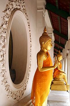 Thailand buddha statues at ancient buddhist temple and stupa of phra pathom chedi, nakhon pathom