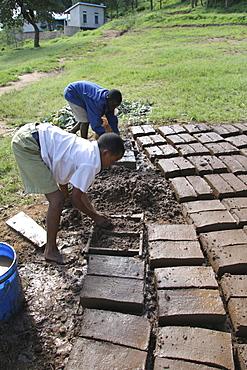 Tanzanian school boys making mud bricks. Kisangara, same, in the north-east near kilimanjaro