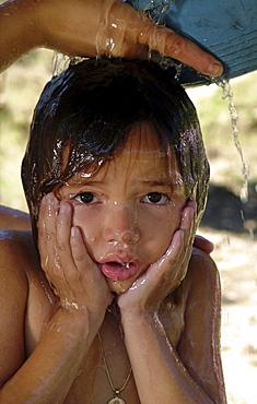 Honduras girl taking a bath, agua caliente, copan