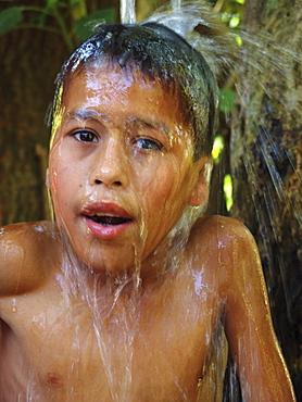 Honduras boy taking a bath, agua caliente, copan