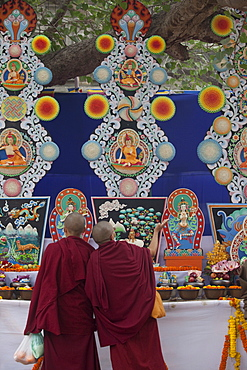 Buddhist monk praying butter statues that is made under the bodhi tree inside mahabodhi temple complex. Kalachakra initiation in bodhgaya, india