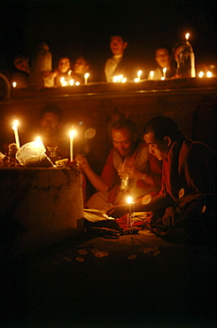 Monks offer butter lamps prayer, kalachakra initiation, bodhgaya. India. Monks attending kalachakra initiation at mahaboudhi temple in bodhgaya, india. mahabodhi temple marks site of buddha's enlightment twenty-five hundred years. centuries have made pilgrimages across himalayas to sites connected with life of historical buddha. From a tantric perspective, pilgrimage is more than paying homage at sacred sites. Rather, it is that activities performed at these places become a memory of place itself. By attuning oneself through ritual meditation to this timeless presence, similar experiences be evoked