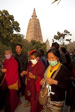 Buddhist pilgrims circumambulate maha bodhi temple in bodhgaya. Kalachakra initiation in bodhgaya, india