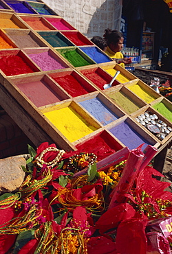 Stall selling coloured powder for rituals at entrance to Pashupatinath Temple, Kathmandu, Nepal, Asia