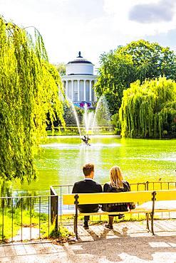 Couple sitting on a bench in Saxon Garden, Warsaw, Poland, Europe