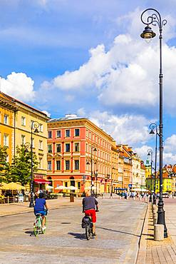 Cyclists cycling in Warsaw, Poland, Europe