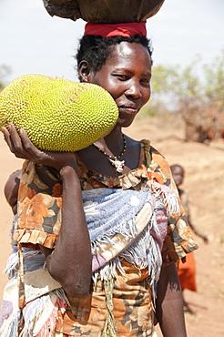Woman holding a jack fruit, Lira, Uganda, Africa